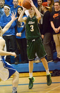 Ed Burke - The Saratogian 02/04/14; Shens' Kevin Huerter drops in three points from outside during the Blue Streaks' loss to the Plainsmen Tuesday night in Saratoga.