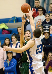Ed Burke - The Saratogian 02/04/14; Shen's Jake Hicks shoots over Saratoga defender Jordan Buchas during the Blue Streaks' loss to the Plainsmen Tuesday night in Saratoga.