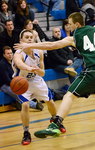 Ed Burke - The Saratogian 02/04/14; Saratoga's Jordan Buchas passes around Shen's Brandon Fischer during the Blue Streaks' loss to the Plainsmen Tuesday night in Saratoga.