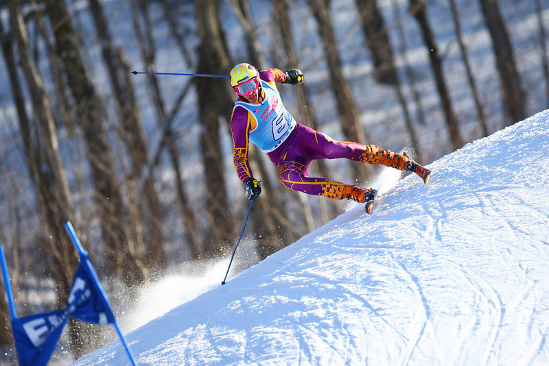 Photo Credit: Lincoln Benedict / EISA<br /> <br /> Williams College's Eric Mann takes the win at the Middlebury Carnival Giant Slalom- despite some rather dramatic moments.