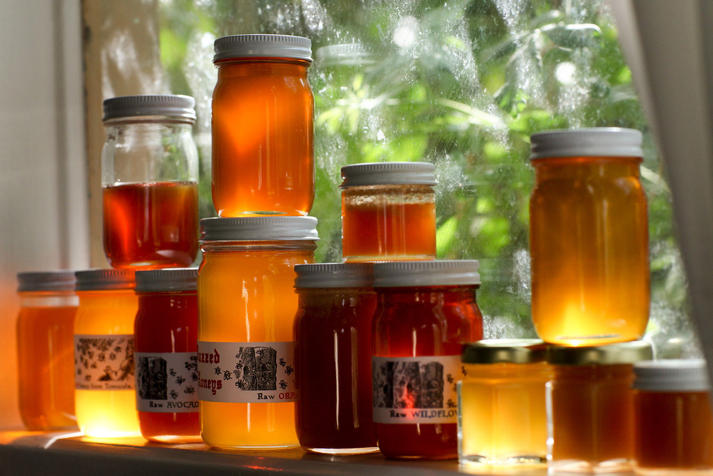 . Jars of Buzzed Honeys sit on a windowsill of David Bock\'s Glassell Park home, Tuesday, February 25, 2014. (Photo by Michael Owen Baker/L.A. Daily News)