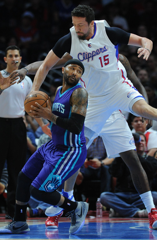 . Hornets Mo Williams is hassled by Clippers#15 Hedo Turkoglu in the first half. The Los Angeles Clippers played the Charlotte Hornets in a regular season NBA game at Staples Center in Los Angeles, CA. March 17, 2015.  (Photos by John McCoy / Los Angeles Daily News)