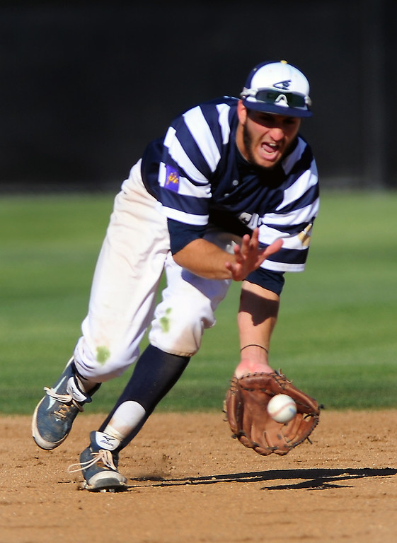 . West Ranch shortstop Jagger Rusconi charges a grounder. (Photo by Michael Owen Baker/L.A. Daily News)