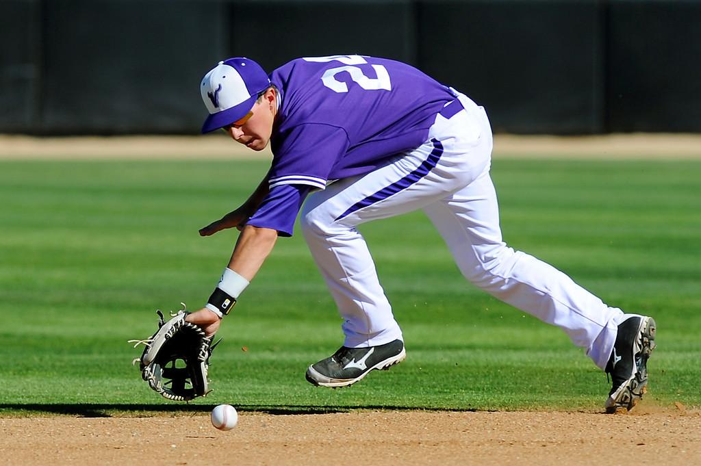 . Valencia second baseman Scott Ogrin fields an infield hit by West Ranch\'s Addison Jackson. (Photo by Michael Owen Baker/L.A. Daily News)