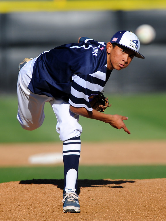 . West Ranch\'s Kyle Paguio pitches in relief against Valencia. (Photo by Michael Owen Baker/L.A. Daily News)