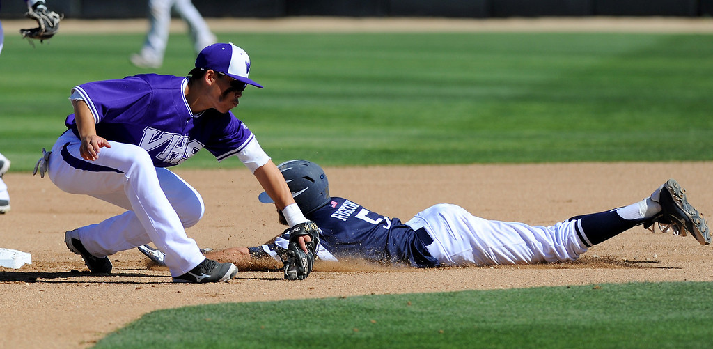 . West Ranch\'s Jagger Rusconi steals second base as Valencia\'s Keston Hiura fields the throw in their Foothill League opener, Wednesday, March 19, 2014, at Valencia. (Photo by Michael Owen Baker/L.A. Daily News)