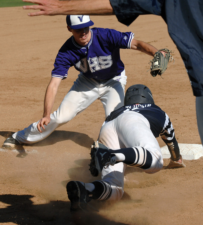 . West Ranch\'s Jake Spurlin dives back to third after oversliding the base, on his hit that scored two runs, before being tagged out by Valencia\'s Hunter Holland in their Foothill League opener, Wednesday, March 19, 2014, at Valencia. (Photo by Michael Owen Baker/L.A. Daily News)