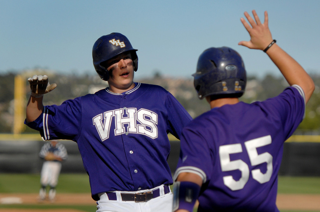 . Valencia\'s Kaden Betsch, left, is congratulated at home by Anthony Lepre after scoring against West Ranch in their Foothill League opener, Wednesday, March 19, 2014, at Valencia. (Photo by Michael Owen Baker/L.A. Daily News)