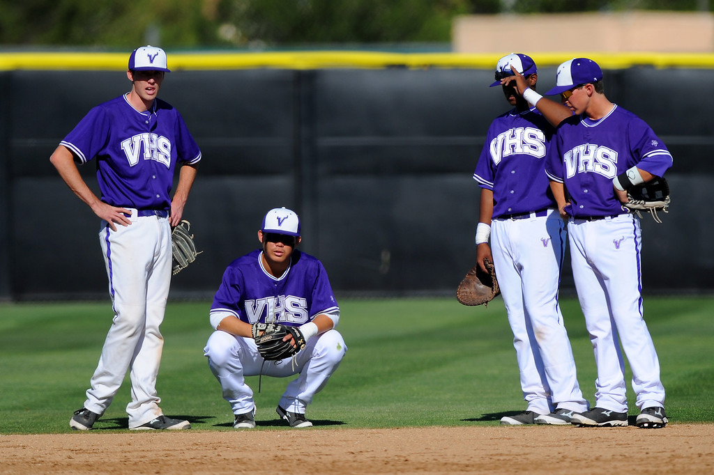 . The Valencia infield gathers during a pitching change. (Photo by Michael Owen Baker/L.A. Daily News)