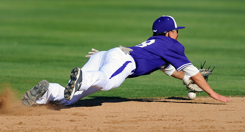. Valencia shortstop Keston Hiura makes a diving attempt on a West Ranch hit up the middle in their Foothill League opener, Wednesday, March 19, 2014, at Valencia. (Photo by Michael Owen Baker/L.A. Daily News)