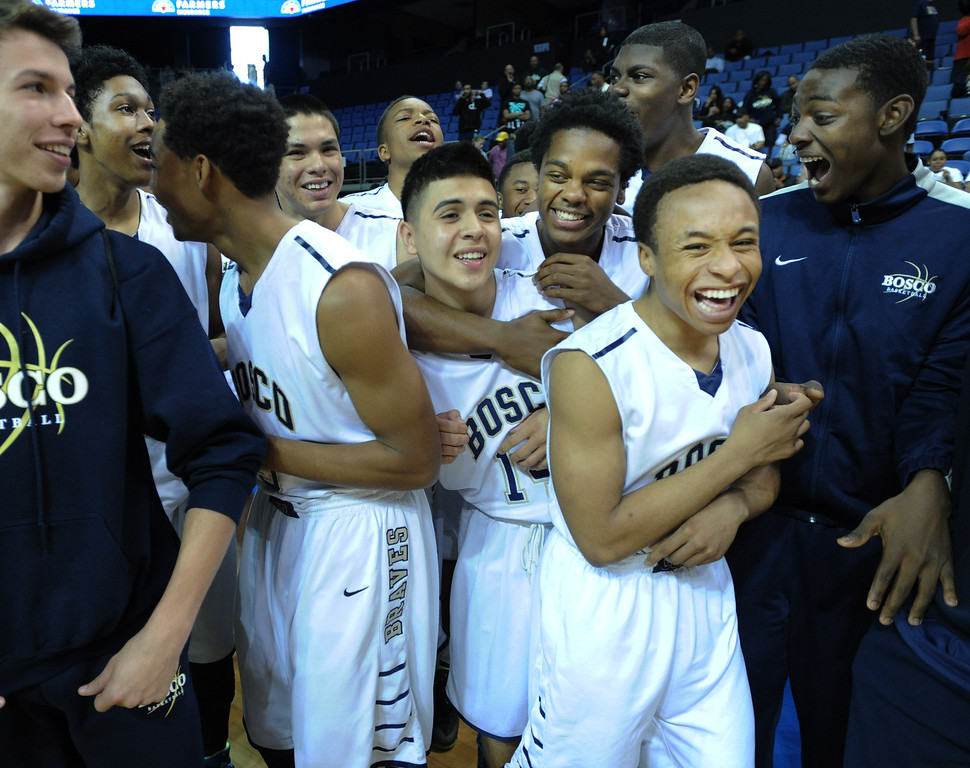 . Bosco celebrates at the conclusion of the game. St. John Bosco defeated Compton 72-55 in the Boys Division II Final game played at Citizens Bank in Ontario, CA. March 22, 2014 (Photo by John McCoy / Los Angeles Daily News)