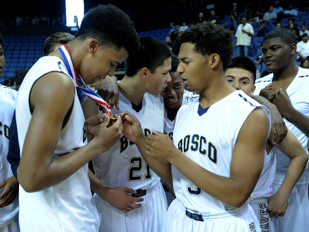. St. John Bosco#10 Vance Jackson shows off his medal to his team mates. St. John Bosco defeated Compton 72-55 in the Boys Division II Final game played at Citizens Bank in Ontario, CA. March 22, 2014 (Photo by John McCoy / Los Angeles Daily News)