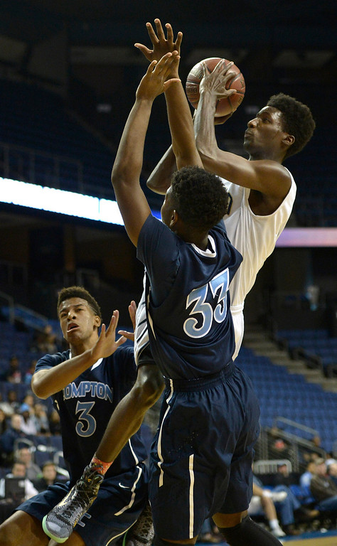 . St. John Bosco#5 Daniel Hamilton shoots over Compton#3 Zeno Lake and Compton#33 Tramelle Prickett. St. John Bosco defeated Compton 72-55 in the Boys Division II Final game played at Citizens Bank in Ontario, CA. March 22, 2014 (Photo by John McCoy / Los Angeles Daily News)