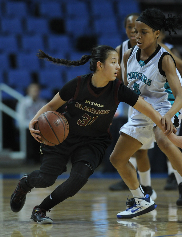 . Alemany#31 Genessa Bedoya drives around Canyon Springs#5 Briane Cheatum. Canyon Springs defeated Alemany 66-51 in the Girls Division I Final game played at Citizens Bank in Ontario, CA. March 22, 2014 (Photo by John McCoy / Los Angeles Daily News)