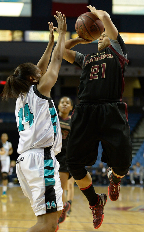 . Alemany#21 Breana Calhoun shoots over Canyon Springs#24 Kennedy Williams. Canyon Springs defeated Alemany 66-51 in the Girls Division I Final game played at Citizens Bank in Ontario, CA. March 22, 2014 (Photo by John McCoy / Los Angeles Daily News)