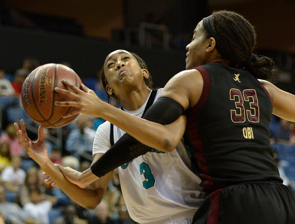 . Canyon Springs#3 Cheyenne Greenhouse gets a hard foul from Alemany#33 Adaora Obi in the final minutes. Canyon Springs defeated Alemany 66-51 in the Girls Division I Final game played at Citizens Bank in Ontario, CA. March 22, 2014 (Photo by John McCoy / Los Angeles Daily News)