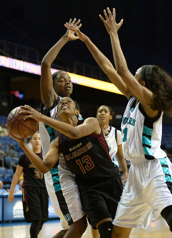 . Alemany#13 Cacie Smith is guarded by Canyon Springs#13 Charnea Johnson Chapman and Canyon Springs#21 Chariaha Scott. Canyon Springs defeated Alemany 66-51 in the Girls Division I Final game played at Citizens Bank in Ontario, CA. March 22, 2014 (Photo by John McCoy / Los Angeles Daily News)