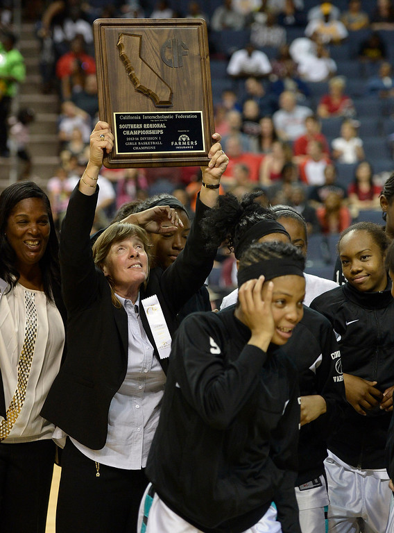 . Canyon Springs Coach Gail Hale holds up the plaque after Canyon Springs defeated Alemany 66-51 in the Girls Division I Final game played at Citizens Bank in Ontario, CA. March 22, 2014 (Photo by John McCoy / Los Angeles Daily News)