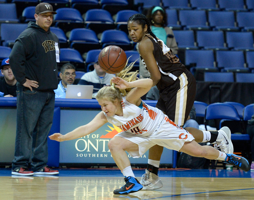 . Chaminade#10 Paige Fecske dives past West#20 Jasmine Jones for a loose ball in the final seconds of the game. Chaminade defeated West High School 67-50 in the Girls Division II Final game played at Citizens Bank in Ontario, CA. March 22, 2014 (Photo by John McCoy / Los Angeles Daily News)