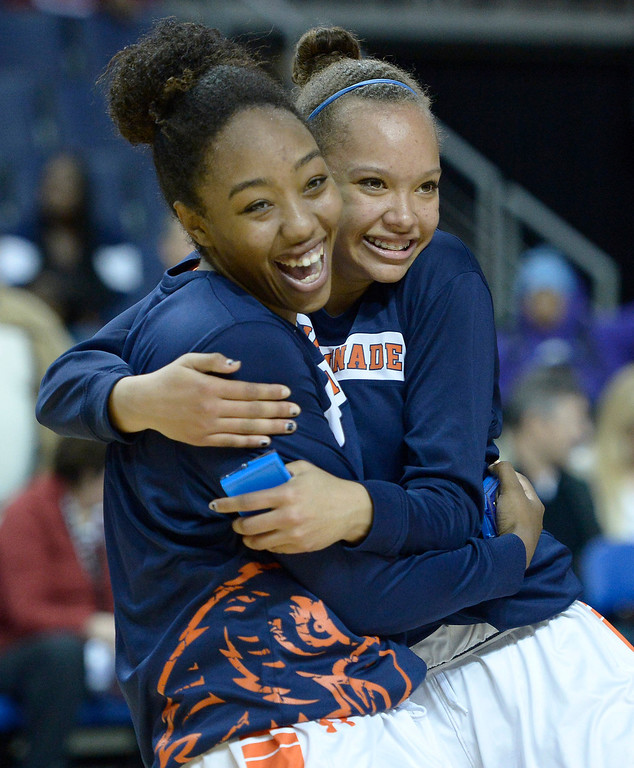 . Chaminade#24 Devin Stanback and Chaminade#22 Valerie Higgins hug during the award ceremony. Chaminade defeated West High School 67-50 in the Girls Division II Final game played at Citizens Bank in Ontario, CA. March 22, 2014 (Photo by John McCoy / Los Angeles Daily News)