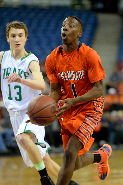 . Chaminade\'s Jordan Ogundiran dishes the ball after driving past Sir Francis Drake\'s Cade Yongue in the CIF-State Division III Finals. (Photo by Michael Owen Baker/L.A. Daily News)