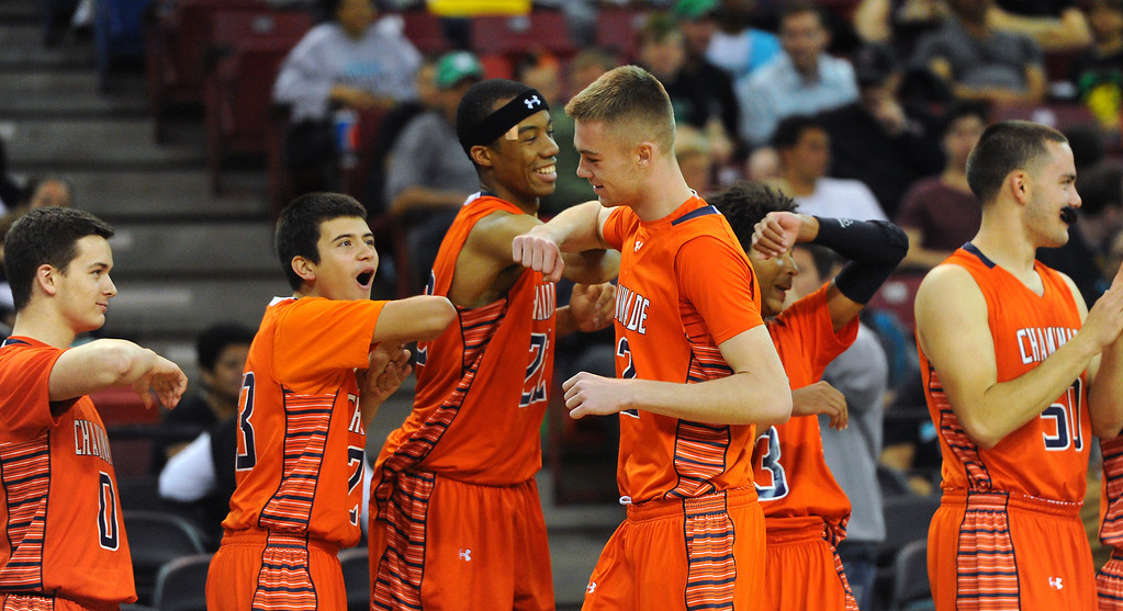 . Chaminade\'s Jack Williams bumps elbows with teammates after missing most of the CIF-State Division III Finals because of illness, Friday, March 28, 2014, in Sacramento. (Photo by Michael Owen Baker/L.A. Daily News)