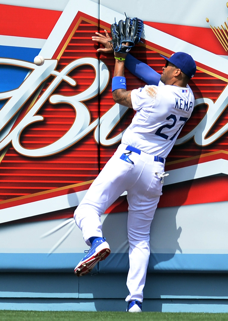 . The Dodgers Matt Kemp goes in to the wall chasing a long fly ball by the Giants\' Brandon Hicks #14 2nd inning during their home opener at Dodger Stadium Friday 4, 2014. The Giants beat the Dodgers 8-4.  (Photo by Hans Gutknecht/Los Angeles Daily News)