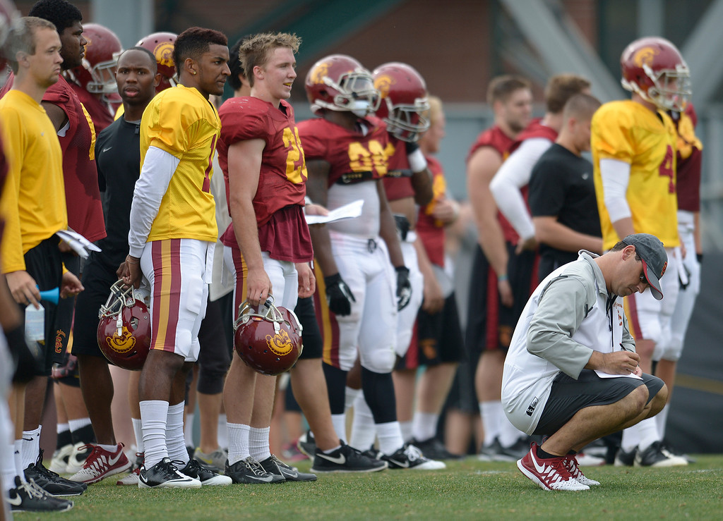. Coach Steve Sarkisian kneels. The coaches at USC are running the Trojans through their paces with spring practices on the school campus. Los Angeles, CA. 4/10/2014(Photo by John McCoy / Los Angeles Daily News)