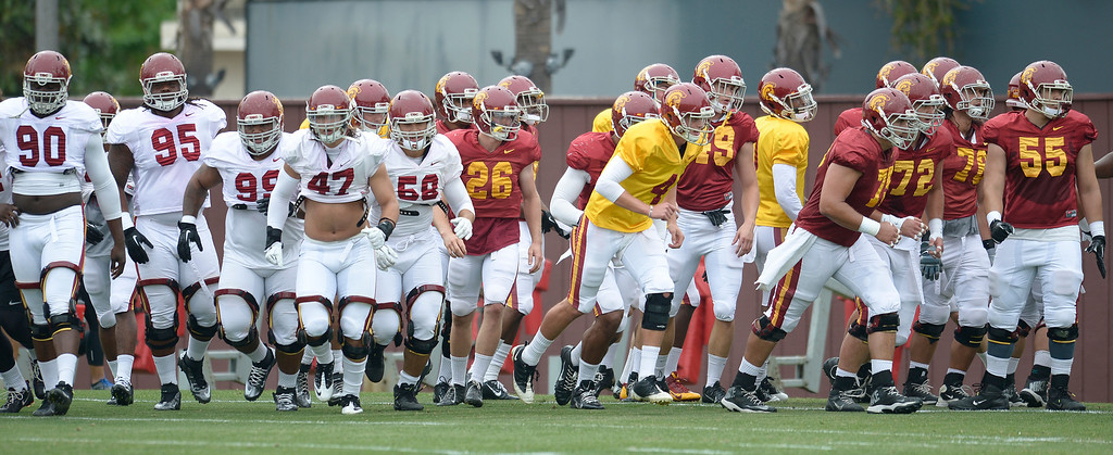 . The Defense in white and Offense in Red run onto the practice field. The coaches at USC are running the Trojans through their paces with spring practices on the school campus. Los Angeles, CA. 4/10/2014(Photo by John McCoy / Los Angeles Daily News)