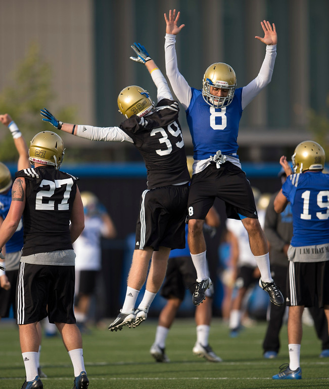 . UCLA\'s Adam Searl #39 and Jalen Ortiz #8 get football practice started at Spaulding Field on the UCLA campus Monday, April 21, 2014. (Photo by Hans Gutknecht/Los Angeles Daily News)