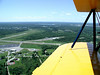 ON DOWNWIND LEG<br /> Here we are on our downwind leg, with Knox County Airport in the lower left corner of the frame and Owls Head right off our left wingtip, across the runway from the airport.