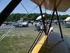 VIEW FROM THE FLIGHT LINE<br /> That's Mary, my benefactor in this little matter, standing by the fence between the truck and the picnic table, as she takes my picture. She'd signed me up for a year's membership which made me eligible for the drawing for the ride, and I won. Woo hoo!!!
