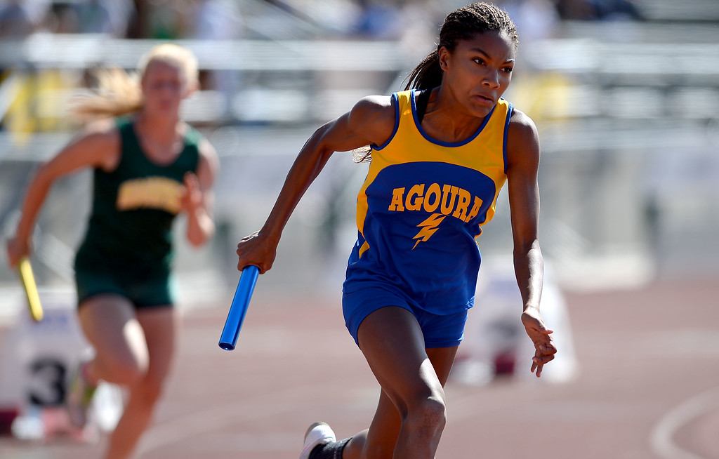 . Agoura\'s Tara Davis during the 4X100 relay during the Marmonte League track and field finals May 9, 2014 in Moorpark.(Andy Holzman/Los Angeles Daily News)