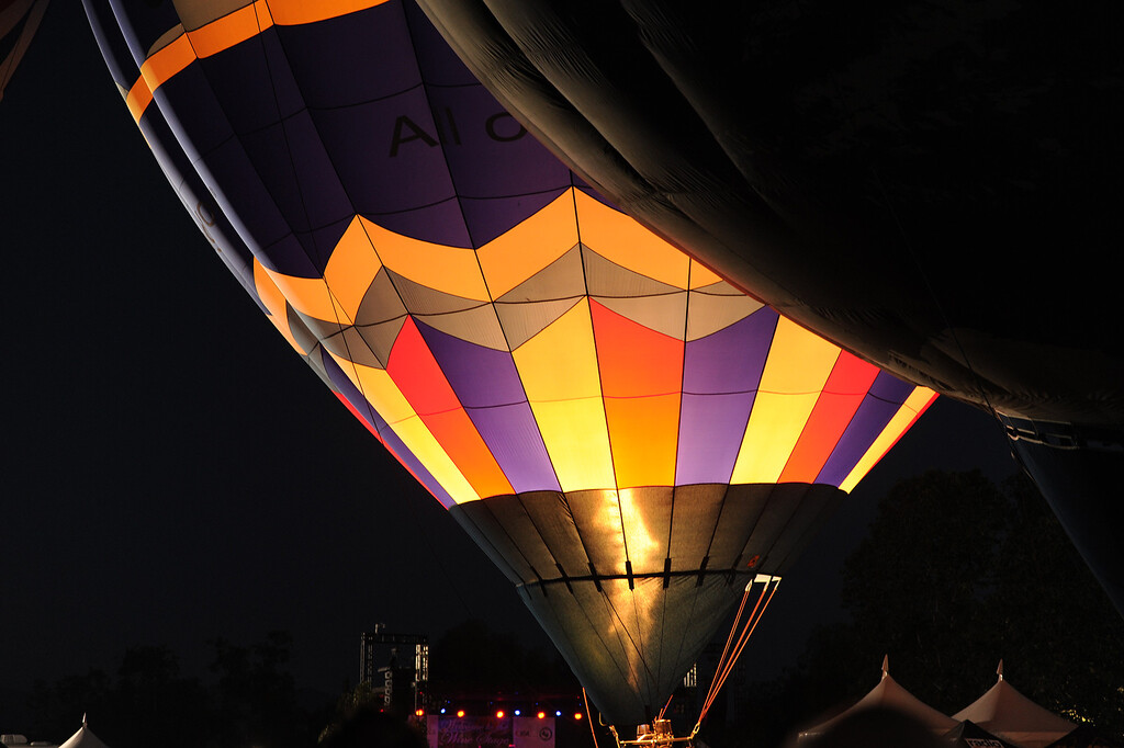. Balloonists prepare to put on a light show for people attending theTemecula Valley Balloon & Wine Festival. At 8:30 in the evening, the balloons would blast their tanks for a moment, and light up the envelopes that are filled with hot air. Temecula, CA 5/30/2015 (Photo by John McCoy Daily News)