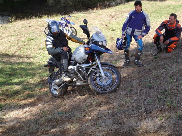 ease off rear brake, turn bars and roll back under control
