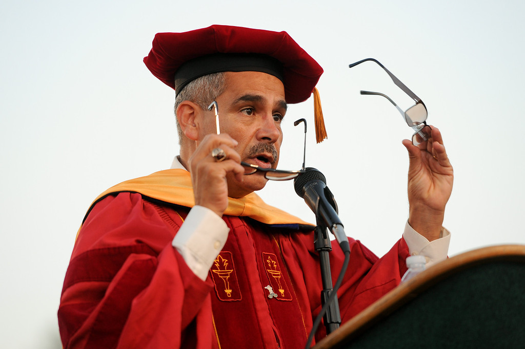 . Principal Luis Rodriguez changes glasses while addressing the Canoga Park graduation, Friday, June 6, 2014. (Photo by Michael Owen Baker/Los Angeles Daily News)