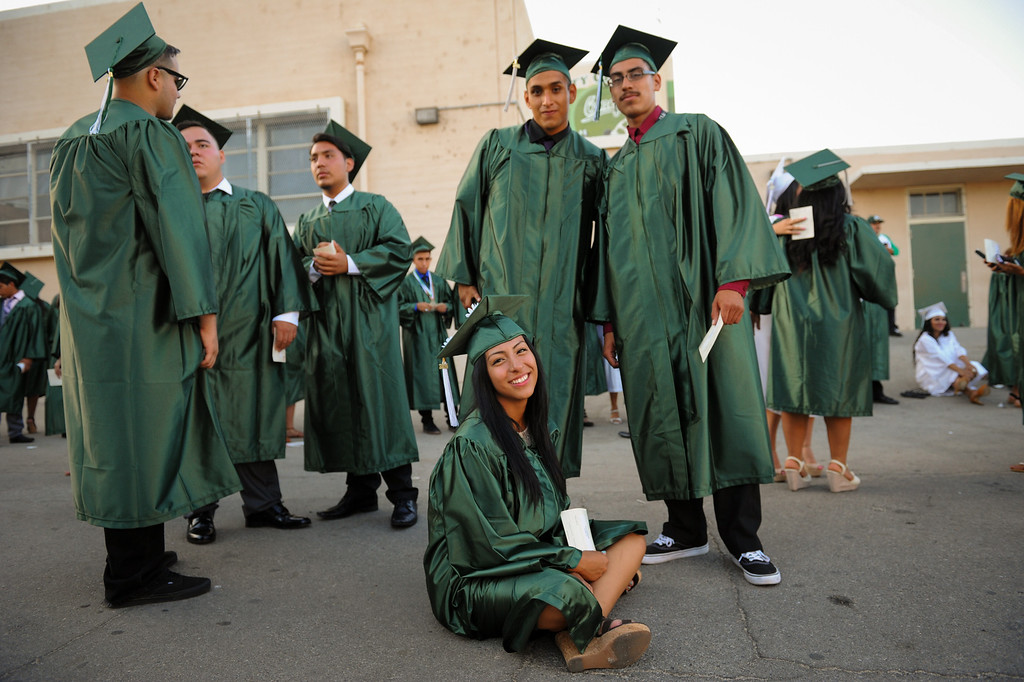 . Grads stand and sit in line before the Canoga Park graduation, Friday, June 6, 2014. (Photo by Michael Owen Baker/Los Angeles Daily News)
