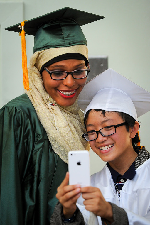 . Jasira Imhotep, left, and Jayden Trinh take a selfie at the Canoga Park graduation, Friday, June 6, 2014. (Photo by Michael Owen Baker/Los Angeles Daily News)