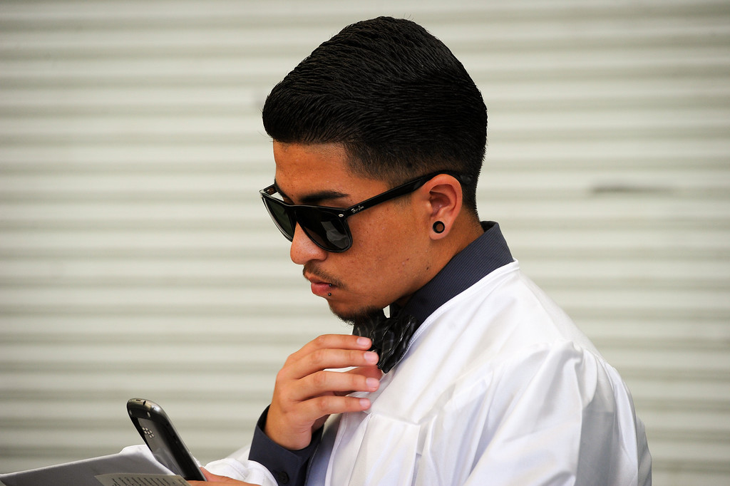 . Jimmy Ramirez checks his bow tie before the Canoga Park graduation, Friday, June 6, 2014. (Photo by Michael Owen Baker/Los Angeles Daily News)