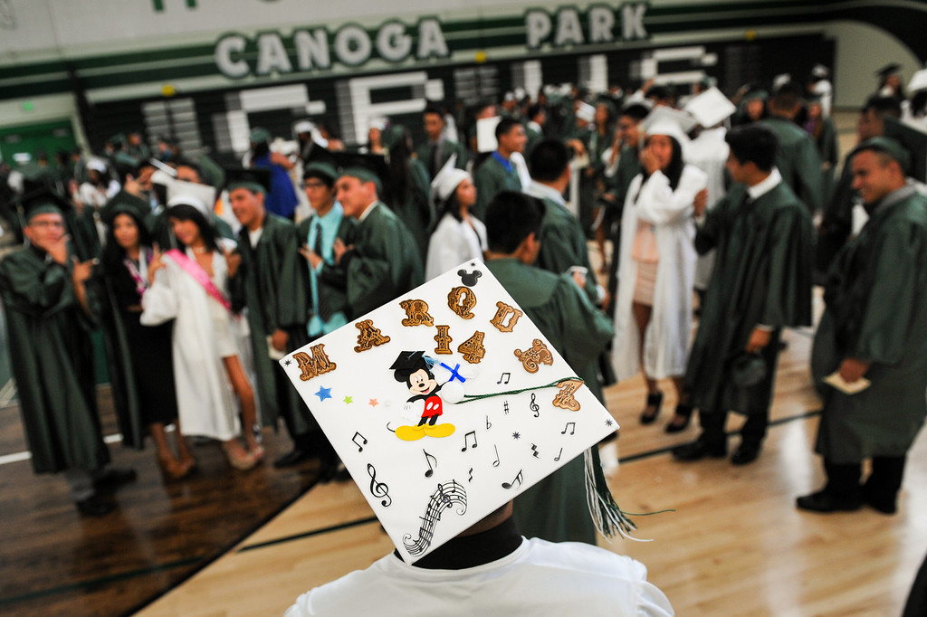 . Mark Marquez sports a decorated mortarboard as grad gather in the gym before the Canoga Park graduation, Friday, June 6, 2014. (Photo by Michael Owen Baker/Los Angeles Daily News)