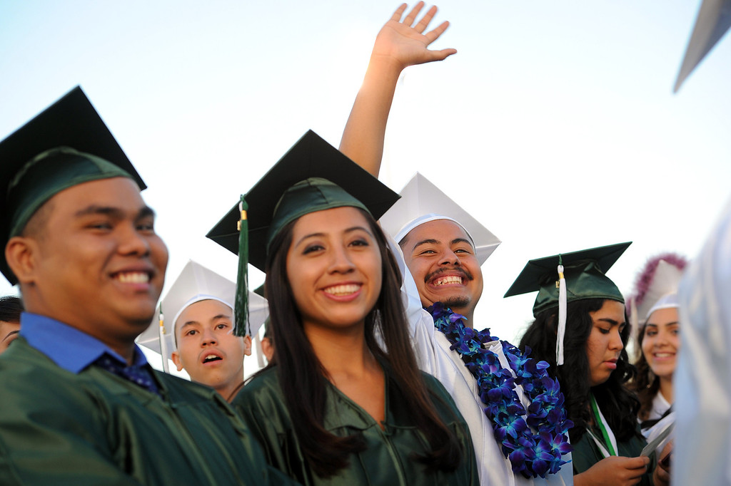 . Mark Marquez waves to family members at the Canoga Park graduation, Friday, June 6, 2014. (Photo by Michael Owen Baker/Los Angeles Daily News)
