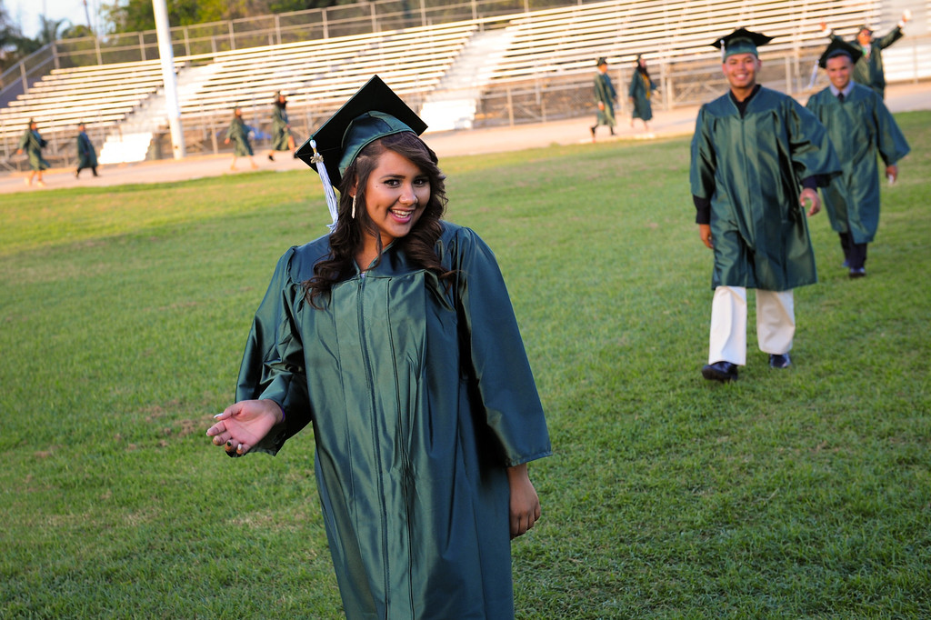 . Kaitlyn Bunch walks into the Canoga Park graduation processional, Friday, June 6, 2014. (Photo by Michael Owen Baker/Los Angeles Daily News)