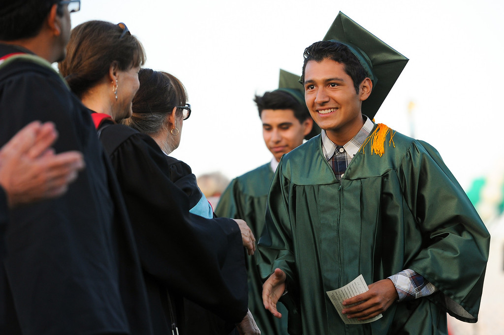 . Graduates shake hands with teachers at the Canoga Park graduation, Friday, June 6, 2014. (Photo by Michael Owen Baker/Los Angeles Daily News)