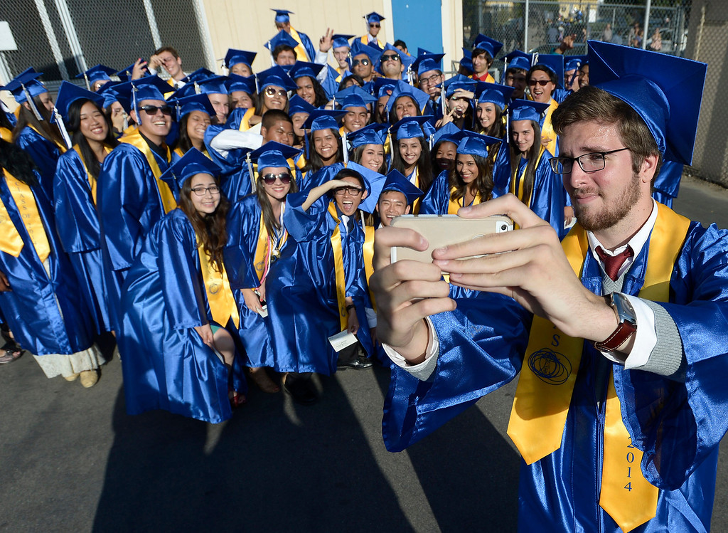 . Andrew Crowley takes a selfie, along with several of his classmates, before the Processional at North Hollywood High School graduation for the class of 2014. Los Angeles, CA. 6/6/2014(Photo by John McCoy Daily News)