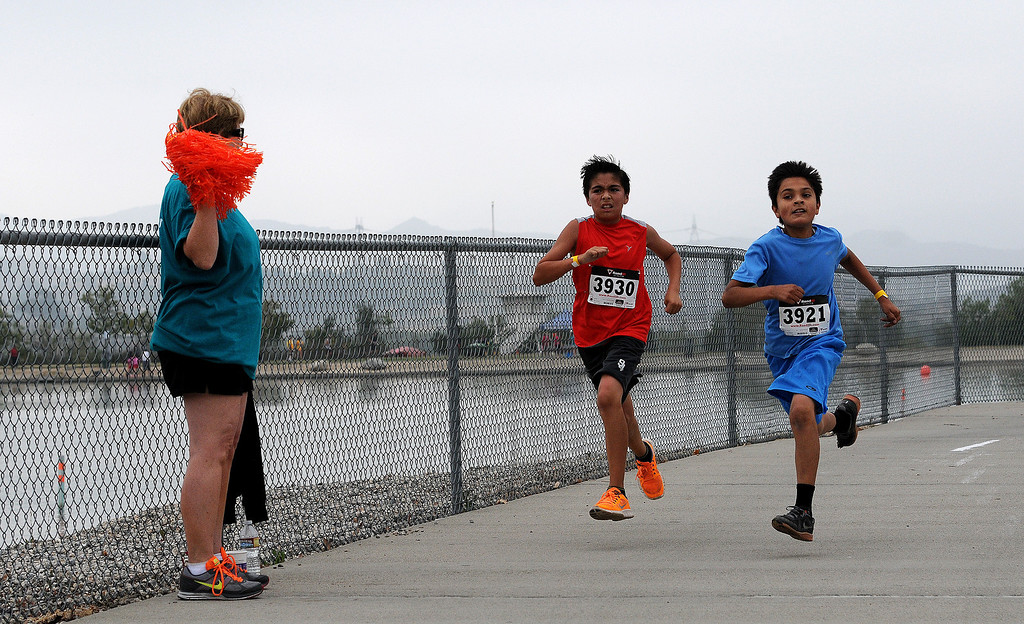. Runners Erynn Garcia, 10, and Jesus Vargas, 11, finish the New Horizons 5k.  New Horizons, the North Hills nonprofit celebrated its 60 years of serving special needs adults Saturday, June 7, 2014, during a 5K walk/run at Hansen Dam with a fitness, health and business expo.  (Photo by Dean Musgrove/Los Angeles Daily News)