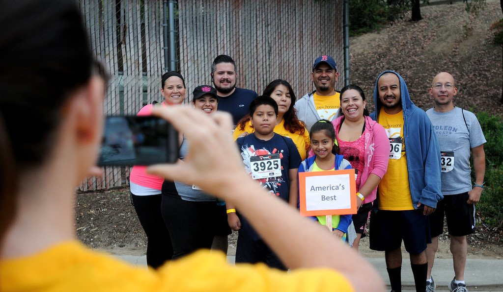 . Runners from the group, Americas Best, pose for a group photo.  New Horizons, the North Hills nonprofit celebrated its 60 years of serving special needs adults Saturday, June 7, 2014, during a 5K walk/run at Hansen Dam with a fitness, health and business expo.  (Photo by Dean Musgrove/Los Angeles Daily News)