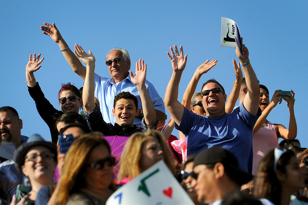 . Family and friends wave to graduates at the Los Angeles Valley College graduation, Tuesday, June 10, 2014. (Photo by Michael Owen Baker/Los Angeles Daily News)
