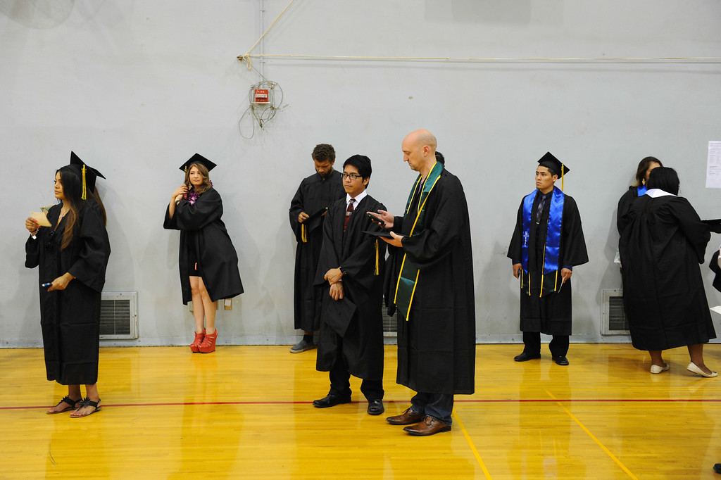 . Grads wait before the Los Angeles Valley College graduation, Tuesday, June 10, 2014. (Photo by Michael Owen Baker/Los Angeles Daily News)