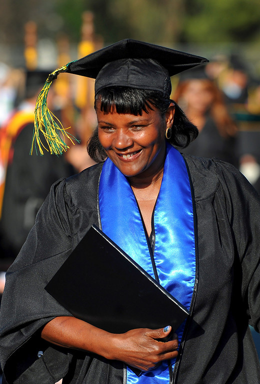 . Stacey Rogers walks with her diploma at the Los Angeles Valley College graduation, Tuesday, June 10, 2014. (Photo by Michael Owen Baker/Los Angeles Daily News)