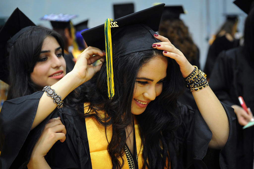 . Hildegard Ackermann gets help with her cap from Lilit Sargsyan before the Los Angeles Valley College graduation, Tuesday, June 10, 2014. (Photo by Michael Owen Baker/Los Angeles Daily News)